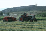 Oren Kimber driving tractor and baling hay on the Kimber Ranch meadow  (GCCS_CTC031_9)