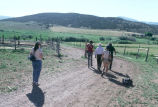 Grouse Creek Cultural Survey fieldwork entourage escorts Winfred Kimber around the Frost farm with...