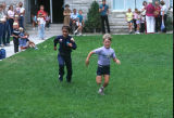 Children's foot races after the 4th of July program (GCCS_CHC002_1)