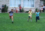 Children's foot races after the 4th of July program (GCCS_CHC002_2)