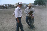 Boy helped off rodeo grounds after calf ride (GCCS_CHC002_20)