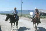 Milt Oman and Barney McWilliams on horseback, getting ready to move cattle in Moulton, Idaho...