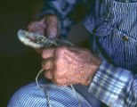 Close up of Wallace Betteridge  braiding a hondo (GCCS_CHC005_9)