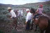 Max, Doug, and Thomas Tanner dismounting for lunch while moving cattle (GCCS_CHC007_4)