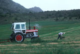 Doug Tanner drags the bailer out,  tests cut hay for moisture (GCCS_CHC008_4)