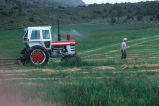 Doug Tanner drags the bailer out,  tests cut hay for moisture (GCCS_CHC008_5)