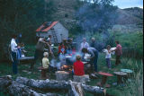 Preparation of dutch oven potatoes, grilled hamburgers and corn (GCCS_CHC010_14)