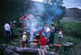 Preparation of dutch oven potatoes, grilled hamburgers and corn (GCCS_CHC010_15)