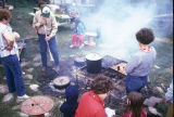 Preparation of dutch oven potatoes, grilled hamburgers and corn (GCCS_CHC010_4)