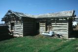 Exterior of the original log house at the Warburton ranch complex (GCCS_CHC013_14)