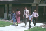 Betty Tanner, Tom Carter and others leaving church after Sunday services (GCCS_CHC015_4)