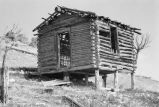 Moroni Tanner cabin on hillside, elevated on stilts to make it level (GCCS_BRR25557_14)