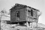 Moroni Tanner cabin on hillside, elevated on stilts to make it level (GCCS_BRR25557_15)