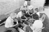 Members of the Oakley, Idaho Arts Council, peel potatoes for the Fourth of July celebration lunch...