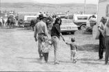 Family in rodeo north parking area (GCCS_BCF231196_6_2)
