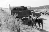 Tom Tanner and friend load horse into truck (GCCS_BCF50409-1_1)