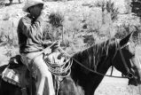 Jay Tanner on horseback during cattle move at sorting lot (GCCS_BCF50409_2_35)