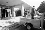 Unloading Grouse Creek archive from truck to Utah State University Library Fife Archive...