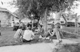 People visiting and relaxing after Independence Day midday meal (GCCS_BCE25511_24)