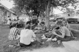 People visiting and relaxing after Independence Day midday meal (GCCS_BCE25511_25)
