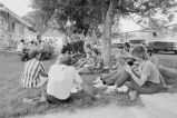 People visiting and relaxing after Independence Day midday meal (GCCS_BCE25511_26)