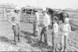 Tom Carter and Mr. Nelson talk with Nelson's nephew at his ranch (GCCS_BHC25552_9)