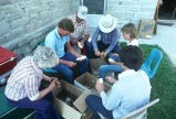 Members of the Oakley Idaho Arts Council peel potatoes for lunch (GCCS_CCF013_1)