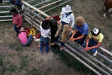 Cowboys rigging up at rodeo (GCCS_CCF018_3)