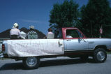 "Fourth of July float carries Ella Tanner, Herbert Tanner, and Winfred Kimber, ""Grouse Creek's..."