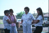 Women visit with each other during 4th of July celebration (GCCS_CCE014_11)