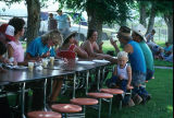 Women and men visit with each other during 4th of July breakfast (GCCS_CCE014_12)