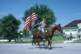 Teenaged riders lead 4th of July parade with U.S. and Utah flags (GCCS_CCE014_13)