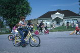 Children ride decorated bikes in the 4th of July parade (GCCS_CCE014_15)