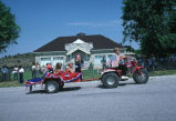 Three wheeler pulls a trailer with kids in 4th of July parade (GCCS_CCE014_16)