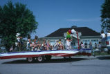 A truck pulls a float with kids in the 4th of July parade (GCCS_CCE014_17)