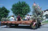 Fourth of July float with sagebrush and flags made by Kathleen Tanner and kids (GCCS_CCE014_20)