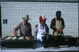 Cooks prepare and serve pancakes and sausage for the 4th of July breakfast (GCCS_CCE014_7)