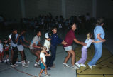 "Children dance the ""Bunny Hop"" at the Grouse Creek, Utah, 4th of July celebration..."