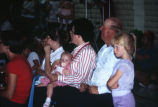Doug and Kathleen Tanner and children watching the Grouse Creek 4th of July variety show...