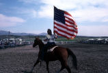 Flag bearer for the 4th of July rodeo (GCCS_CCE017_1)