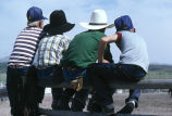 Rodeo spectators lined up against fence during 4th of July celebration (GCCS_CCE018_14)