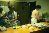 Women in kitchen preparing refreshments and cleaning up afterwards at the Brian and JoLene (K....