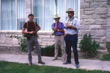 Carl Fleischhauer, Thomas Carter and Hal Cannon n front of the school at the noontime picnic...