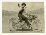 Photograph of J. Bracken Lee on a motorcycle, 1915