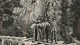 Members of Logan Scout Troop 5 standing on a trestle bridge in Logan Canyon, Utah, between 1915...