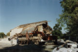 Demolition of Mendon Elementary School, 1991, wide view from the front showing an excavator