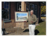 Justin Anderson in front of painting of Mendon Station