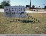 Cart supporting sign, Texas, 1968