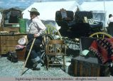 Selling antiques at Golden Spike Festival, Promontory Point, Utah, 1977