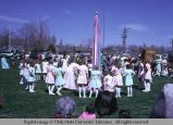 Dancers getting in position to wind the Maypole, Mendon, Utah, 1975